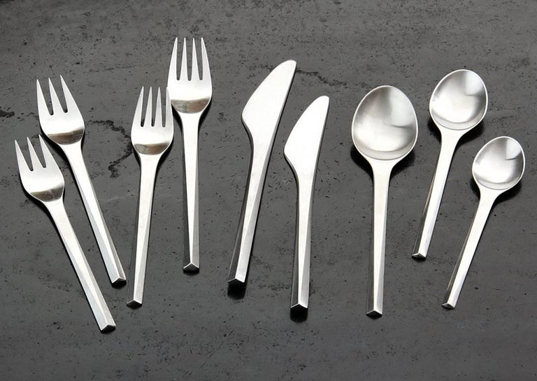 A service for one (1), of matte stainless steel from the Prism cutlery series. All pieces stamped