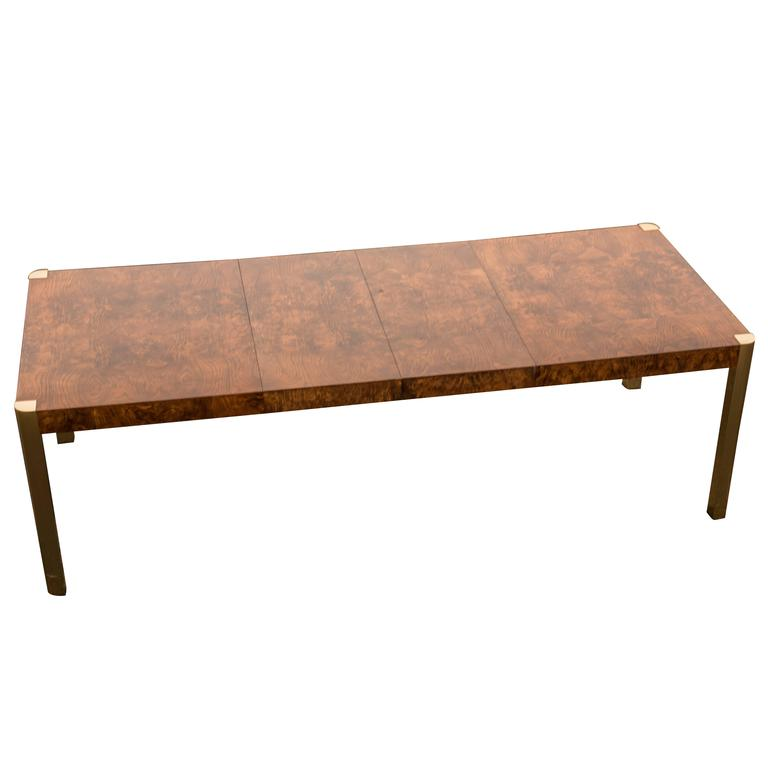 this sleek burl wood and brass dining table with two leaves is no