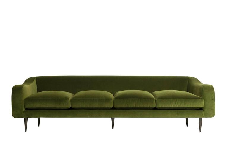 Mid-Century Modern sofa designed by Joaquim Tenreiro. Brazilian rosewood (jacaranda) legs. Newly upholstered in green cotton velvet. Pair of matching armchairs available.
