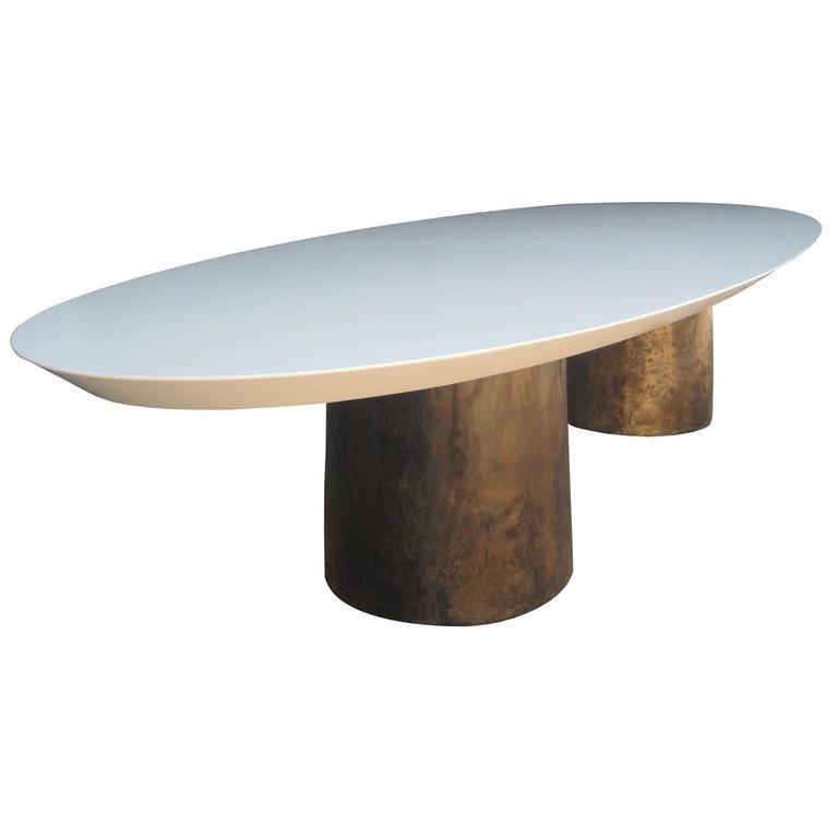 benone oval dining table cast bronze bases knife edge custom