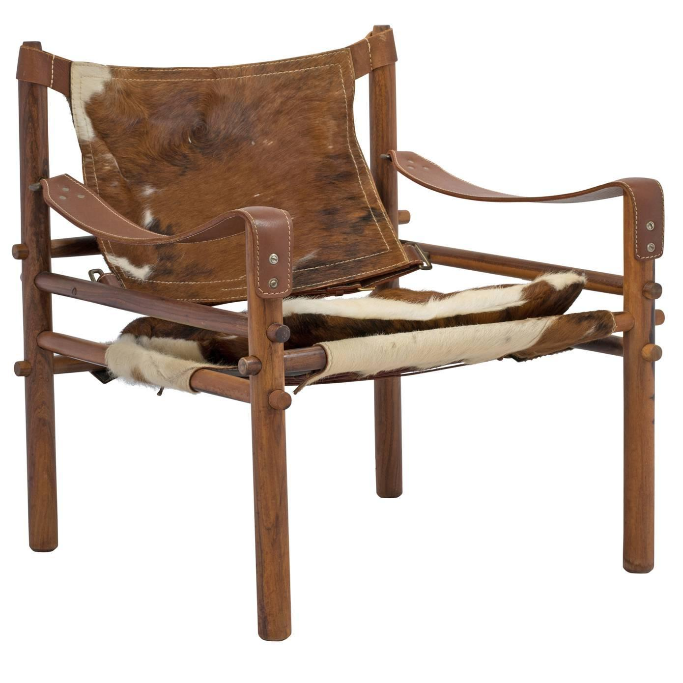 Arne Norell Sirocco Safari Chair in Rosewood and Cowhide at 1stdibs