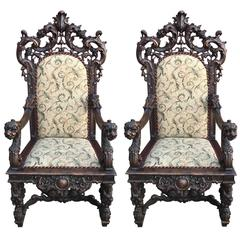 Highly Carved Pair of Rococo Throne Chairs with Cream Cushions