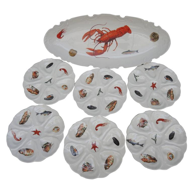 Fish Set Including a Large Platter and Six 1960s French Porcelain Oyster Plates 1