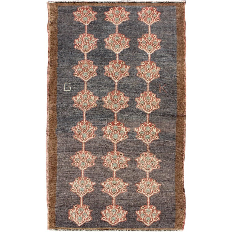 Navy Paisley Rug: Turkish Tulu Carpet With Several Paisley Medallions On A