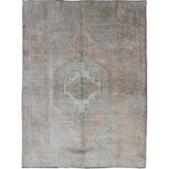 Mid-Century Muted Vintage Turkish Oushak with Central Medallion Design