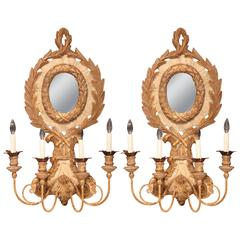 Large Pair of Italian Carved Wood and Iron Painted Sconces with Centre Mirror