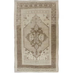 Vintage Turkish Oushak  rug in Taupe and Earth Colors