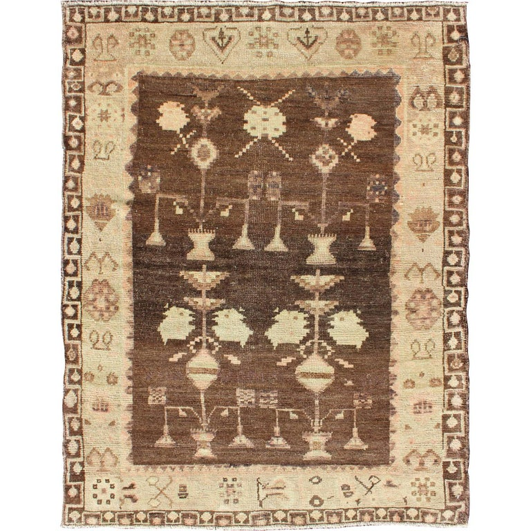 Vintage Turkish Oushak Carpet with Tribal Design Set on Brown Background