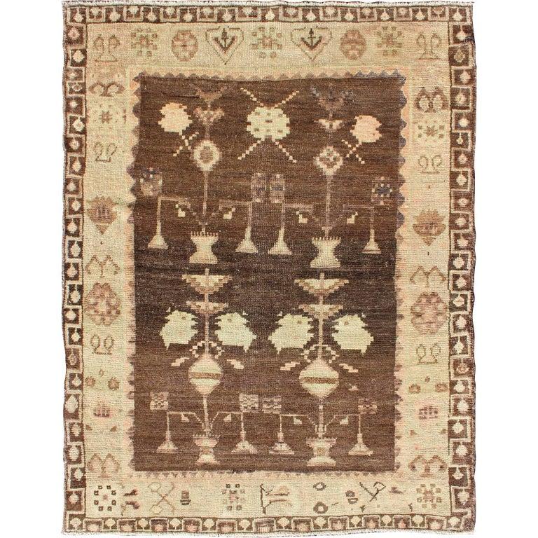 Vintage Turkish Oushak Carpet with Tribal Design Set on Brown Background