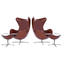 Pair of Arne Jacobsen for Fritz Hansen Egg Chairs and Footstools, Denmark, 1965