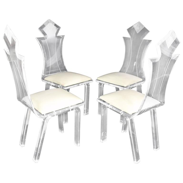 Set of Four Carved Bent Lucite Dining Chairs