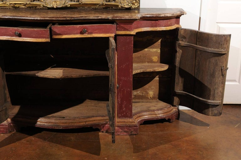 Wood Venetian Red Painted Serpentine Front Credenza with Two Drawers over Four Doors For Sale