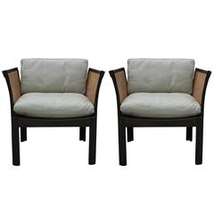 Pair of Illum Wikkelso Leather and Cane Danish Lounge Chairs Holger Christiansen