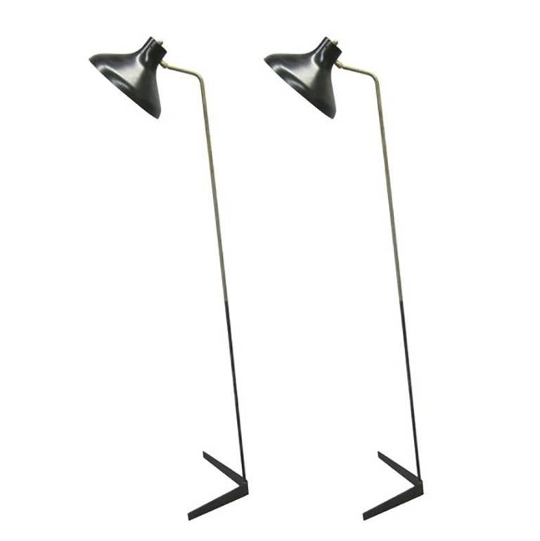 2 Sleek, Elegant Italian Mid-Century Modern Standing Lamps by Giuseppe Ostuni for O Luce.   The base and stem set on an angular pattern and the reflector / shade is capable to rotate up, down and around in any direction to create a dramatic,