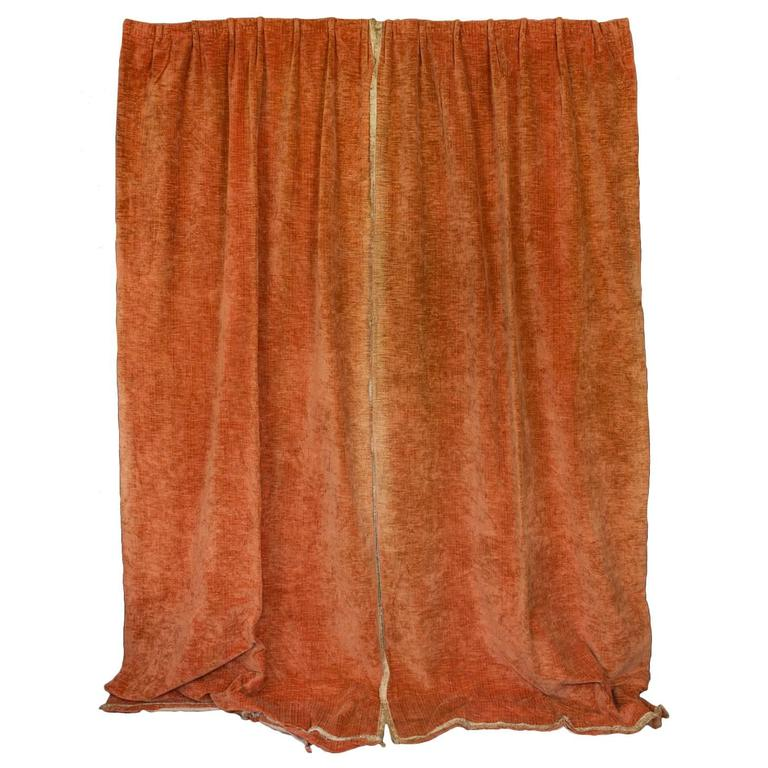 pair of orange velvet drapes with fringe trim 1