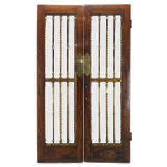 Pair of Glass Paneled Oak Doors with Bronze Hardware
