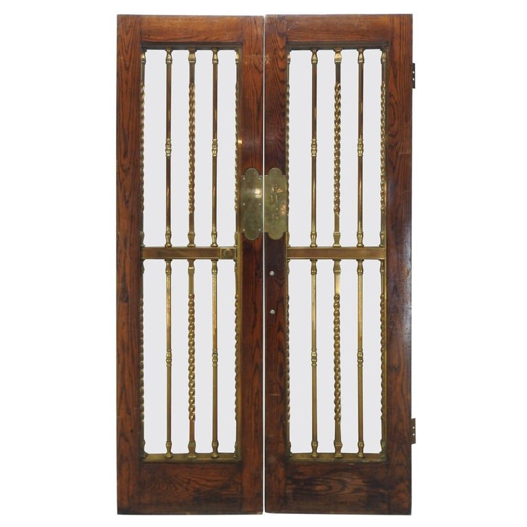 Pair of Glass Paneled Oak Doors with Bronze Hardware