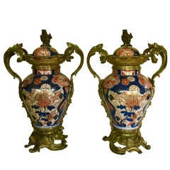 Impressive and Decorative Pair of Imari Baluster Vases with Ormolu Mounts