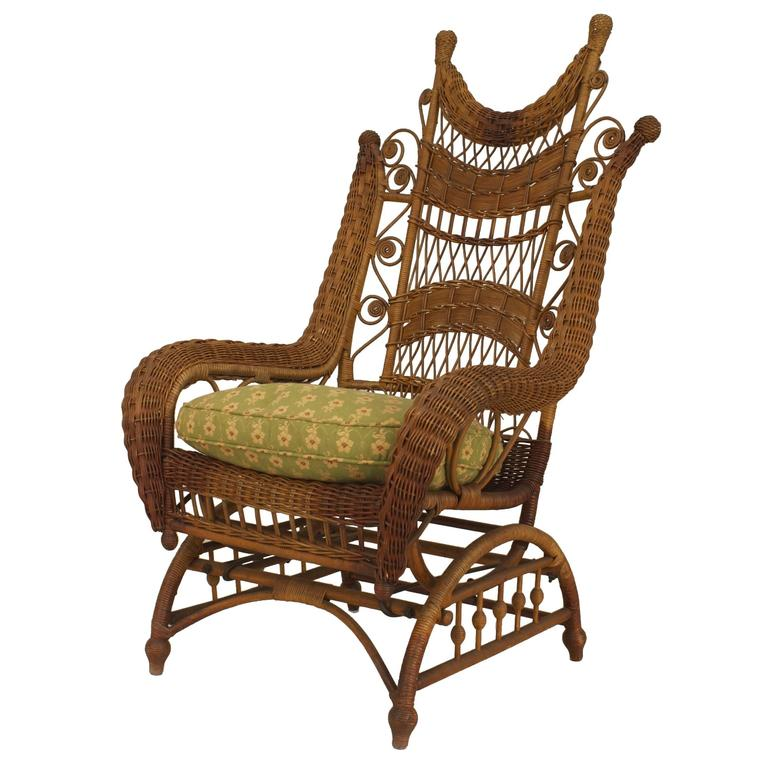 Ornate Wicker Platform Rocking Chair For Sale at 1stdibs