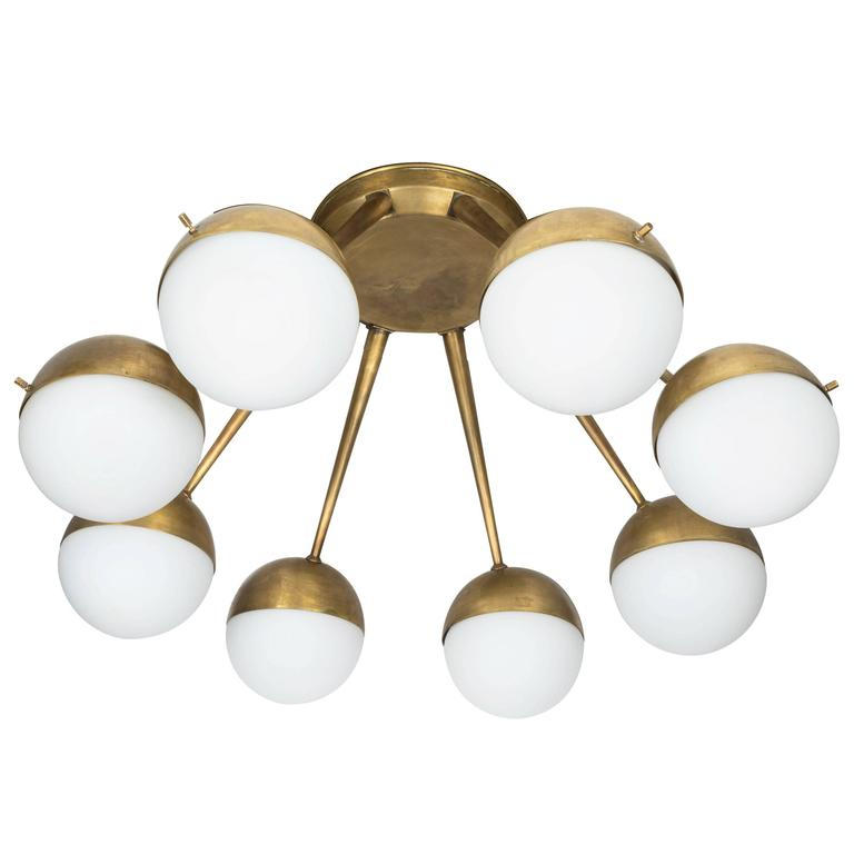 1960s Italian Eight-Arm Brass and Glass Chandelier Attributed to Stilnovo For Sale