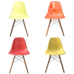Four Multicolored Herman Miller Eames Dining Chairs