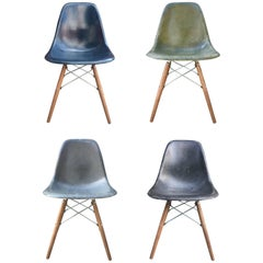 Four Multicolored Eames Dining Chairs