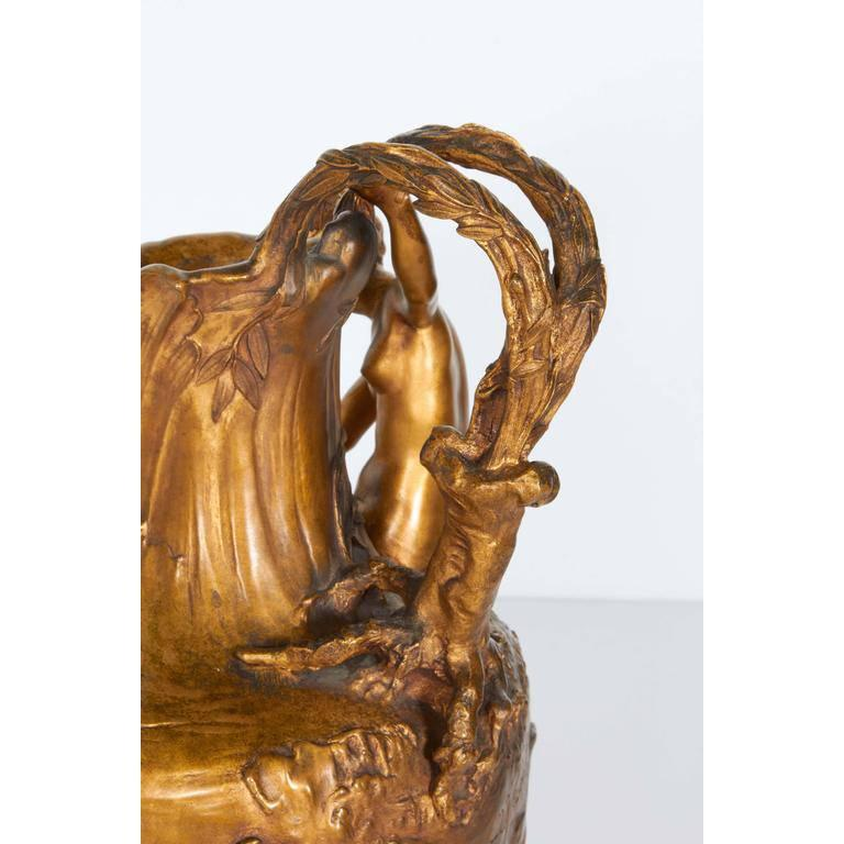 """An Art Nouveau gilt bronze lobed ewer by Alexandre Vibert (French, 1847-1909), produced within the early 20th century period, depicting a classical nude female figure on the bank of a body of water. Markings include signature """"A.Vibert""""."""