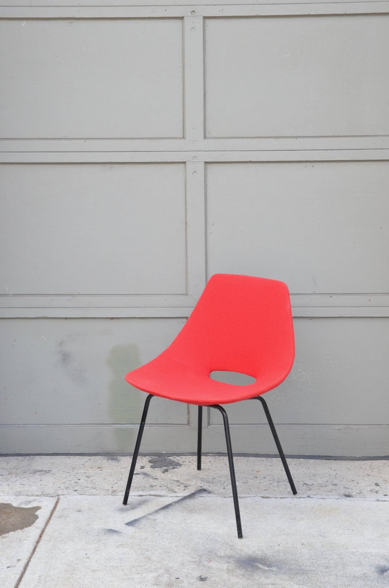 Very clean pair of all-original bent plywood and fabric Tonneau chairs by Pierre Guariche. For Steiner, Paris. Circa 1955.  Early years  Pierre Guariche was born in 1926, son of a family of Parisian goldsmiths. He studied at the École nationale