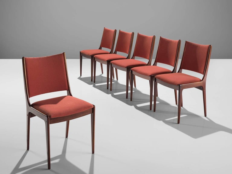 Dining chairs, rosewood, pink fabric, Denmark, 1950s  This stately set of six chairs with rosewood frame has a high back upholstered in a deep pink fabric. The chairs have a well executed solid frame with soft angles and a modest aesthetic. The