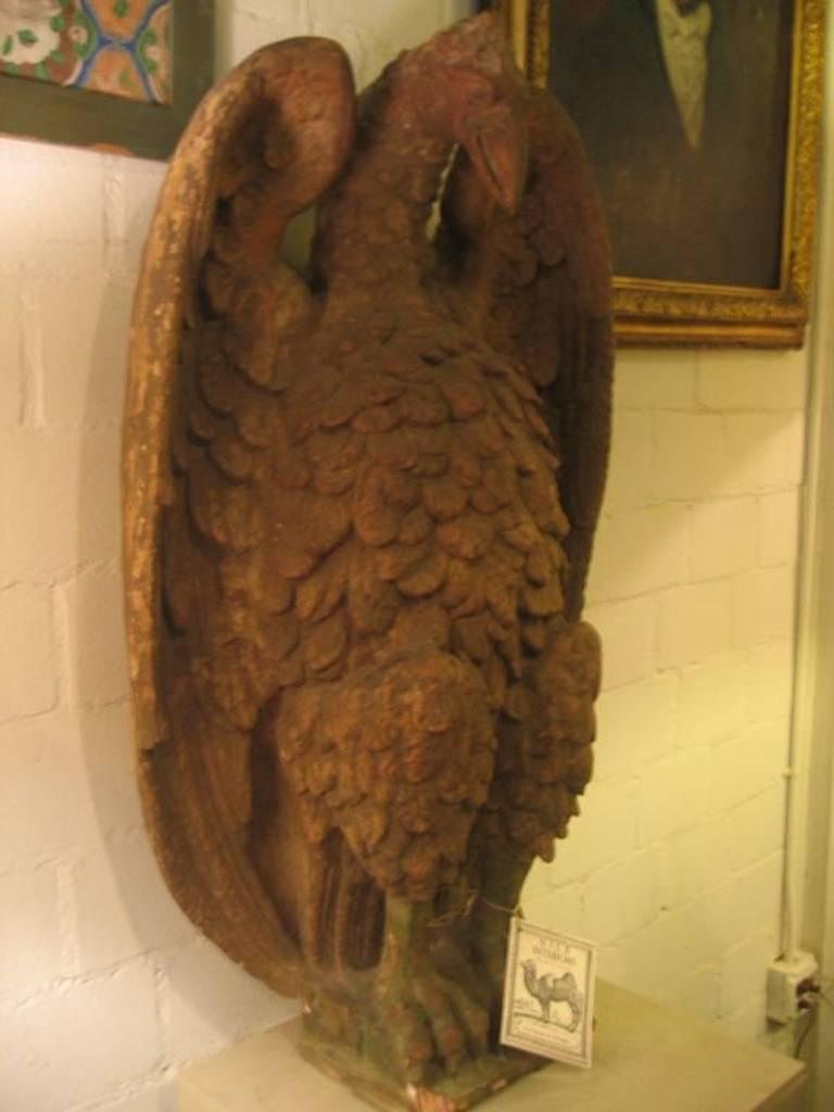 Pair of French 18th century terra cotta eagle sculptures.