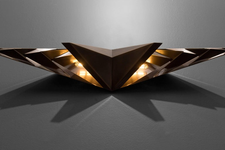Parenthetical light was included in Bellevue Art Museum's 2016 Biennial: Metalmorphosis, along with work selected by a distinguished national jurors of 49 metalsmiths from the Pacific Northwest. This sconce, which was designed as a centrepiece in a