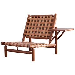 Ilmari Tapiovaara Patined Cognac Lounge Chair with Ottoman
