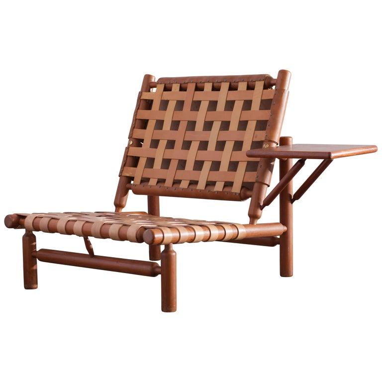 Ilmari Tapiovaara Patined Cognac Lounge Chair with Ottoman