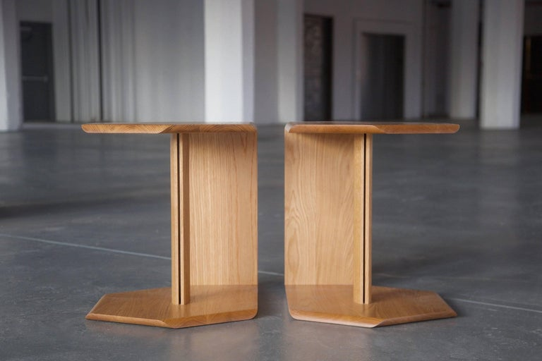 """TARR is a multi-use side table designed to sit on either side of a bed or seating area. Details include an impeccably smooth alternating bevelled edge and a central division.   Dimensions: 18"""" W x 20"""" H x 22"""" D  All of our pieces are"""