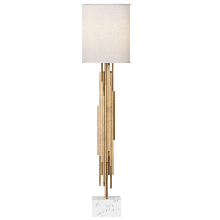 The Ambroise floorlamp is a sculptural fete featuring gold leafed wood. Polished brass, Carrara marble and a white linen shade finish this piece off. Light bulbs: 1 – standard medium base – 60 watt max (not included). Fully custom and made to order