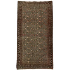 Distressed Rare Antique Khotan Samarkand Gallery Rug with Pomegranate Design