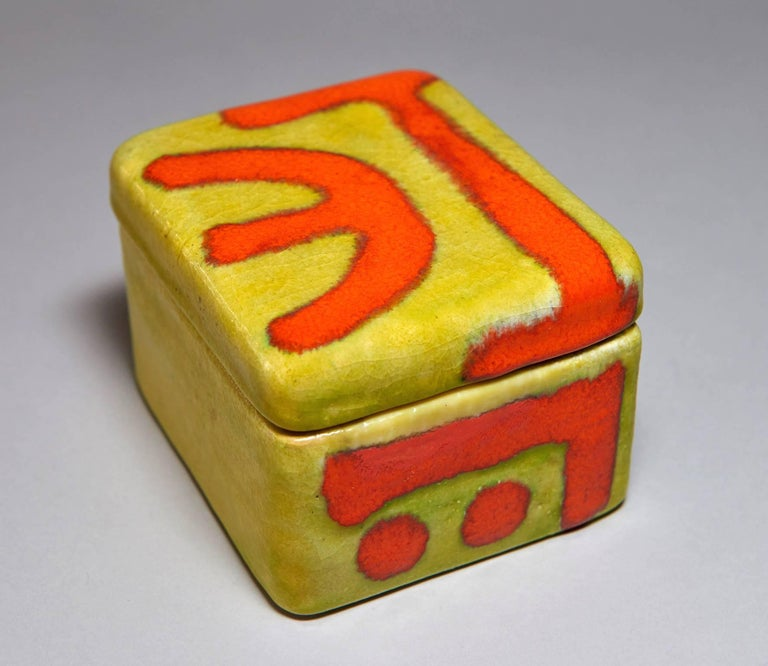 This boldly glazed, covered ceramic box was made by Italy's foremost post-war ceramist -- Guido Gambone -- in his Florence, Italy atelier in the 1950s. It can be used to house jewelry, candies, nuts, cigarettes, keys, and the like. Signed GAMBONE