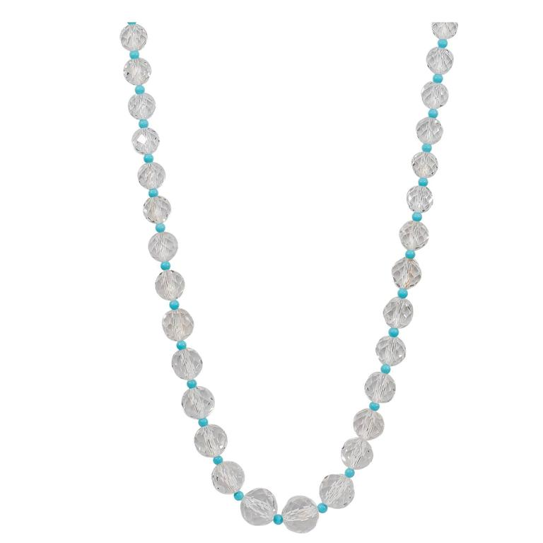 Beautiful necklace featuring crystal and Sleeping Beauty turquoise beads finished with Naomi Sarna's signature 18K yellow gold and VS-FG white diamond clasp.  The crystals graduate from 6.5mm to 14mm in diameter. The turquoise beads are 4 mm in