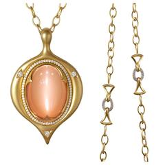 Divine Glowing Cat's Eye Peach Moonstone White Diamond Gold Amulet Necklace