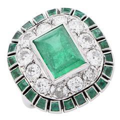 1920s Sugarloaf Cabochon Cut Emerald and Diamond 18 Karat White Gold Ring