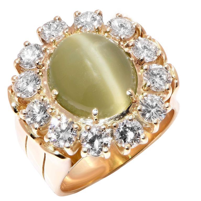 Gubelin 4 Carat Cats Eye and Diamond 18 Karat Yellow Gold Lady's Ring
