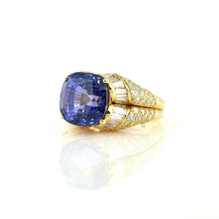 Excellent Bulgari Diamond and Sapphire ring. This center stone is a 14.13 carat Sri Lanka sapphire. The stone has a GIA certificate (can provide upon request) stating the stone has no indications of heat treatment. The stone measures 12.31 x 12.15 x