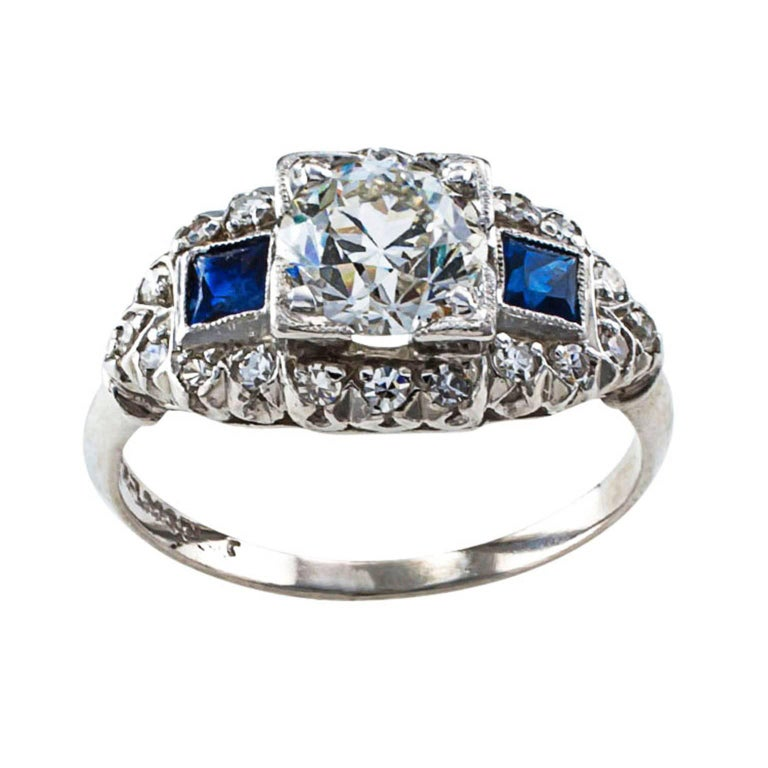 .92 Carat Diamond and Sapphire Art Deco Engagement Ring  The Real Thing! Genuine late Art Deco engagement ring displaying emerging changes in design gravitating to the modernist and lavish lines that would become known as Retro and Mid Century.