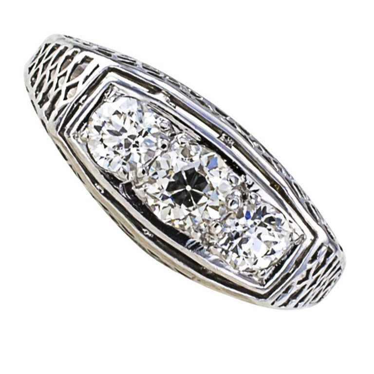 Three-stone Art Deco Filigree Diamond Ring  Nearly three quarters of a carat and exceptional diamond quality for the period, and a very nice three stone design too, simple with eye-tickling pierced work that is both intricate and quite delicate.