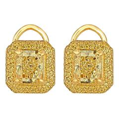 Two Yellow Radiant Diamonds Set in Gold Earring Mountings