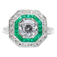 Vivacious Double Halo 0.80 Carat Diamond and Emerald Ring in Platinum