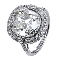 6.53 Carat Cushion Cut Diamond Ring with Baguette and Round Diamonds in Platinum