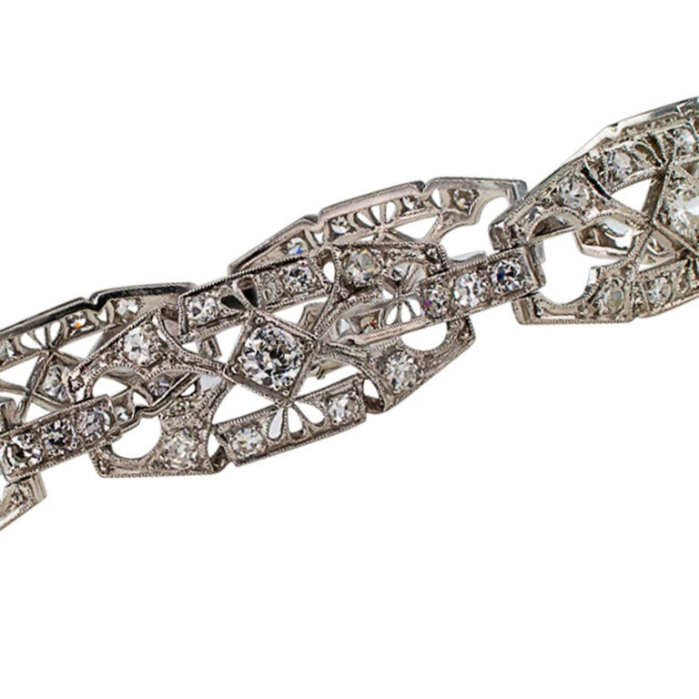 1930s Art Deco Diamond and Platinum Bracelet  1930's Art Deco 2.75 carats diamond bracelet mounted in platinum.  This Art Deco design is characterized by an airy and lace-like appearance provided by the open work links decorated with millegrain,