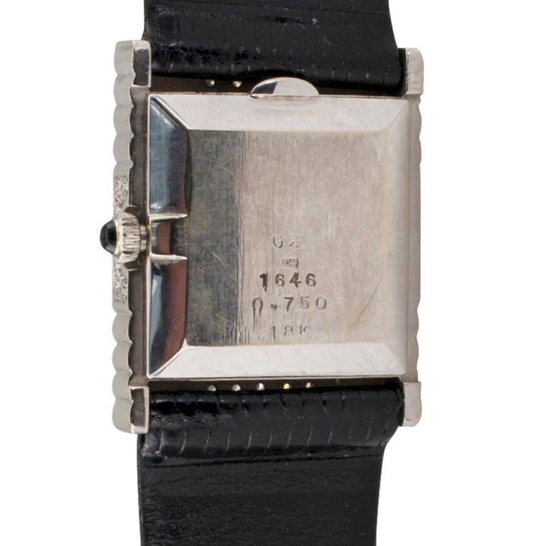 DeLaneau Diamond Tuxedo Wristwatch  DeLaneau 18-karat white gold and diamond tuxedo wristwatch circa 1970.  The geometric inspired rectangular case pave with diamonds totaling approximately 1.00 carat, to the square black dial signed DeLaneau,