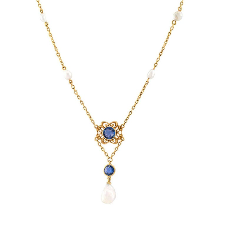 Art Nouveau Sapphire and Pearl Necklace Attributed to Krementz  Art Nouveau pearl and sapphire necklace mounted in 14-karat gold attributed to Krementz circa 1905.  Decorated on the front by an organic motif defined by delicate open work centering
